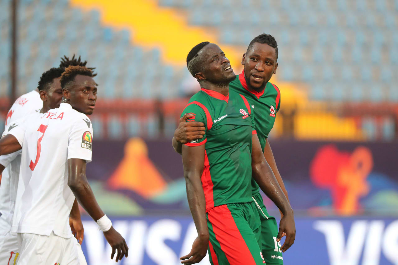 Nduwarugira Christophe of Burundi reacts in disappointment after red card, consoled by teammate Omar Moussa during the 2019 Africa Cup of Nations Finals football match between Burundi and Guinea at the Al Salam Stadium, Cairo, Egypt on 28 June 2019 ©Gavin Barker/BackpagePix
