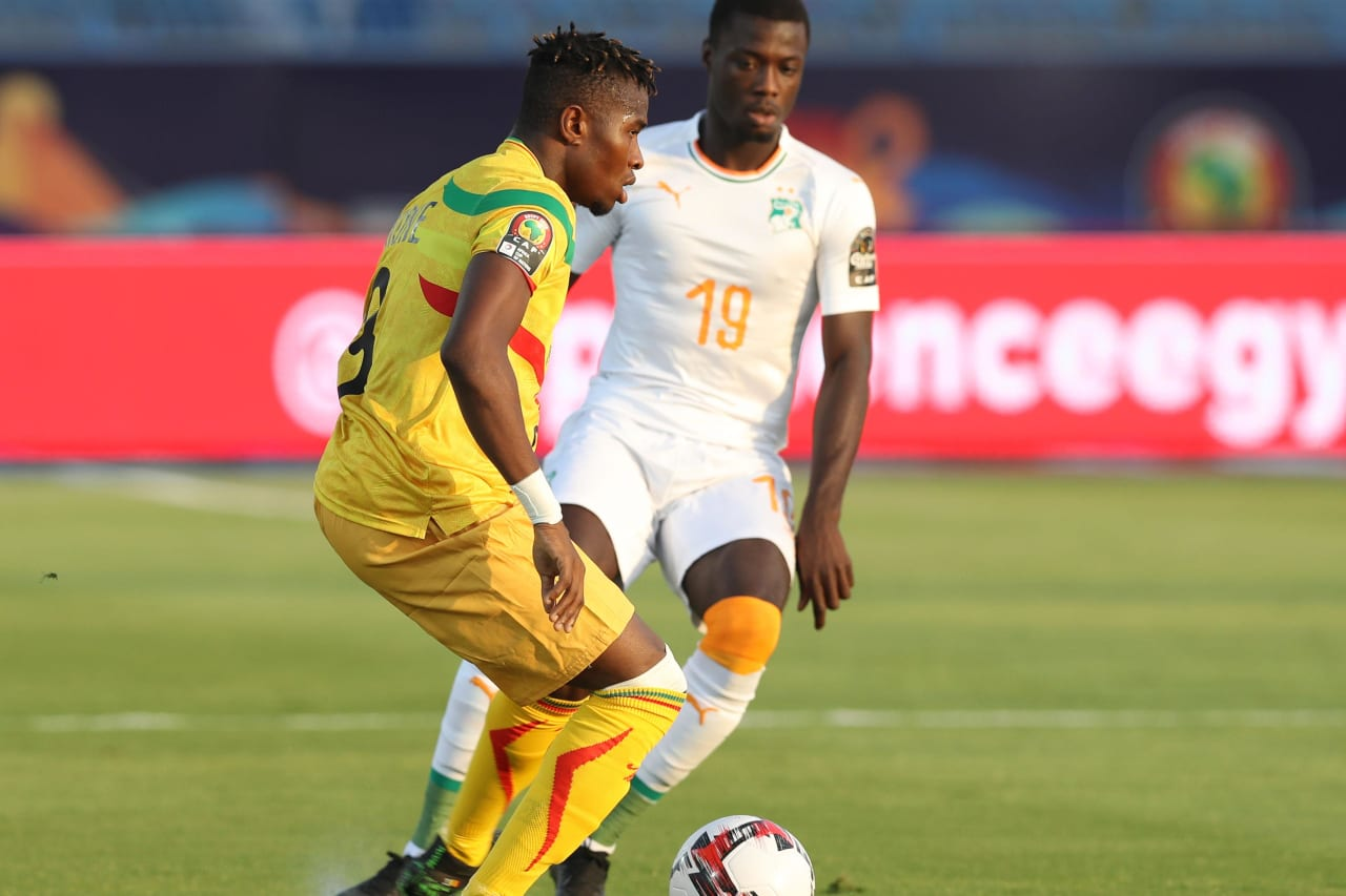 Youssou Kone of Mali challenged by Nicolas Pepe of Ivory Coast during the 2019 Africa Cup of Nations Finals last 16 match between Mali and Ivory Coast at Suez Stadium, Suez, Egypt on 08 July 2019 ©Samuel Shivambu/BackpagePix