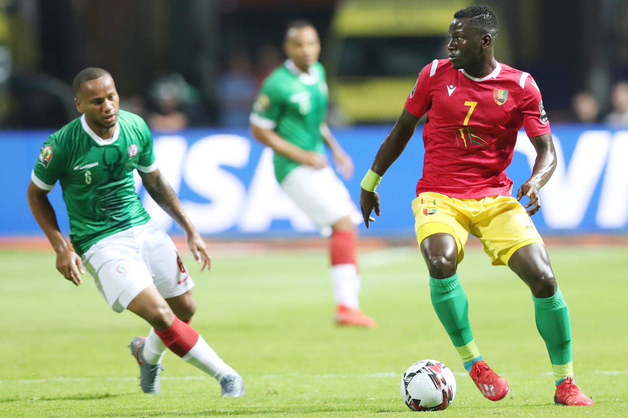 Mohamed Mady Camara of Guinea challenged by Marco Ilaiharitra of Madagascar during the 2019 Africa Cup of Nations Finals match between Guinea and Madagascar at the Alexandria Stadium, Alexandria on the 22 June 2019 ©Muzi Ntombela/BackpagePix
