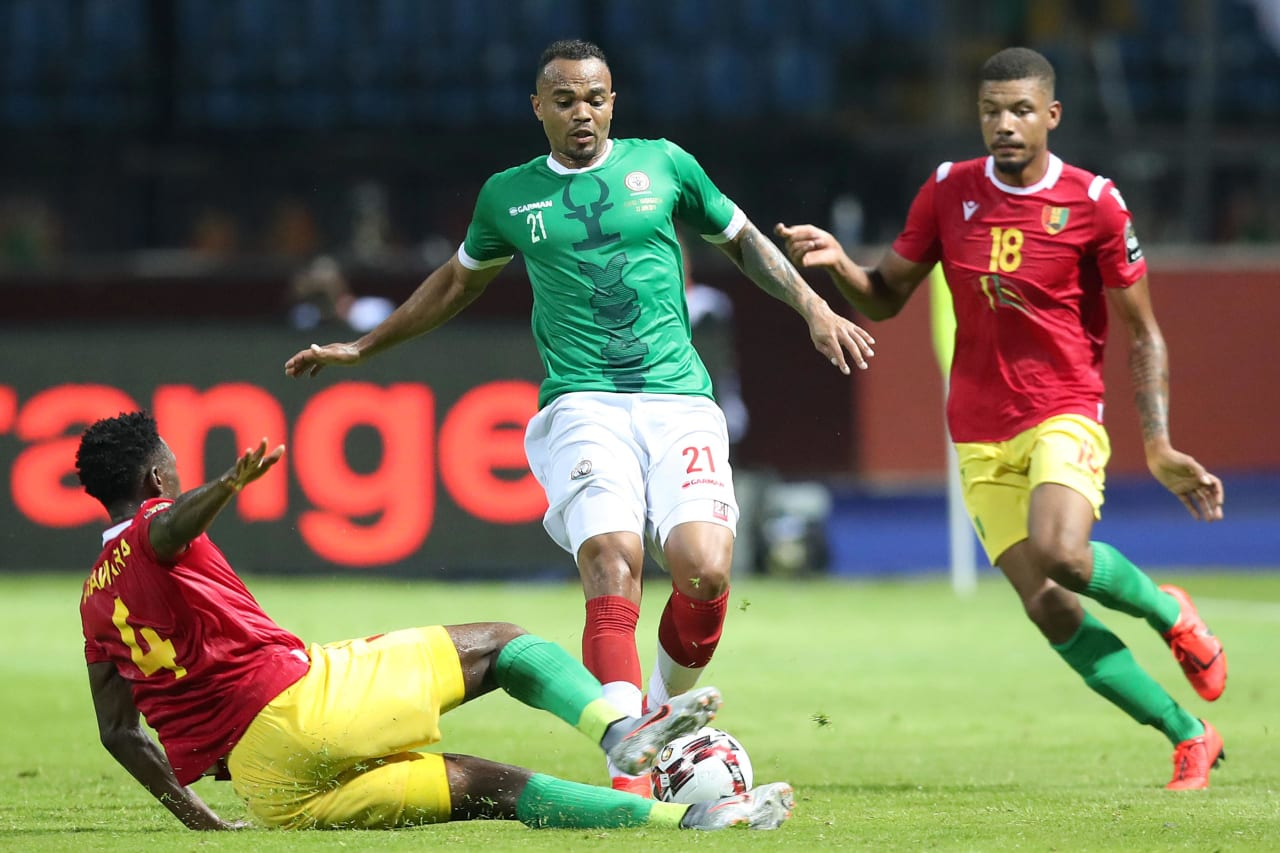 Thomas Fontaine of Madagascar tackled by Amadou Diaara and Dyrestam Mikael Bertil of Guinea during the 2019 Africa Cup of Nations Finals match between Guinea and Madagascar at the Alexandria Stadium, Alexandria on the 22 June 2019 ©Muzi Ntombela/BackpagePix